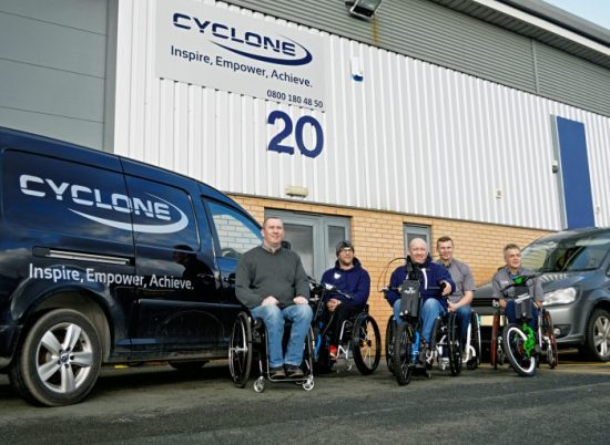 Cyclone team at front of Widnes mobility showroom and offices showcasing a variety of wheelchairs and Batec's