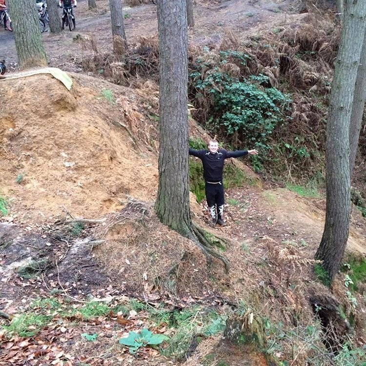 Alex toon case study image pre-injury showing the size of a jump on a mountain bike course