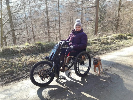 Jane walks her dog up Moel Famou with Batec Electric