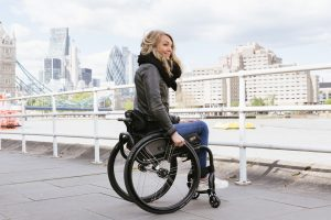 Sophie Morgan in her Aria Wheelchair in front of Tower Bridge